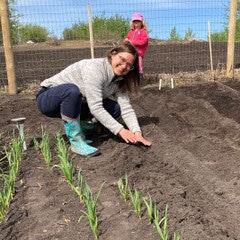 Julie Kusiek tending a garden